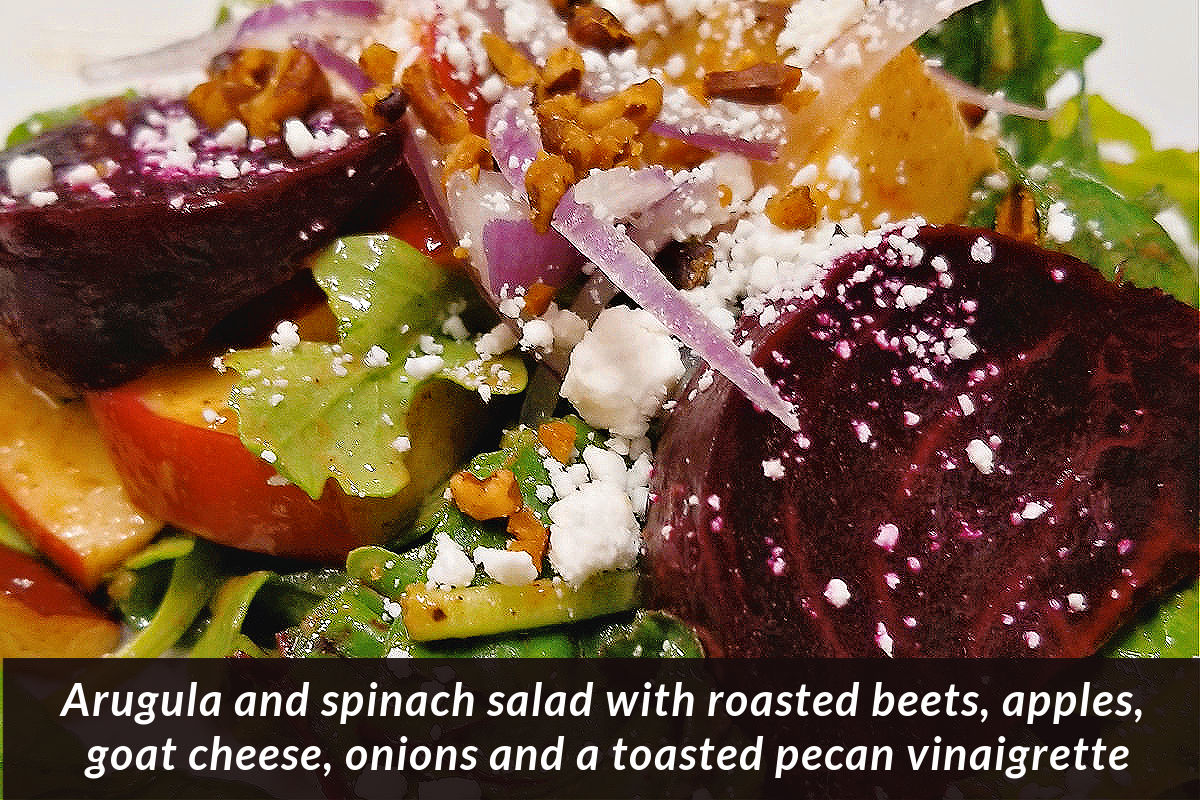 Arugula and Spinach salad with roasted beets, apples, goat cheese, onions and a toasted pecan vinaigrette by Chef Tony Outer Banks Brewing Station