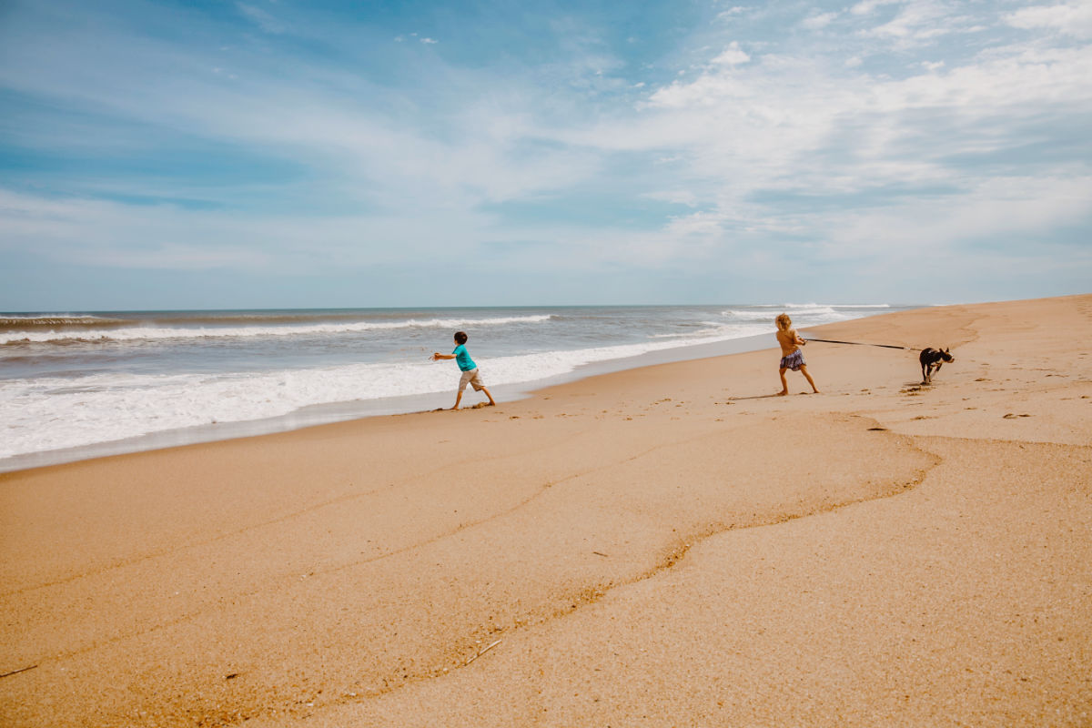 Families flocking to outer banks beach north Carolina SAGA Realty and Construction