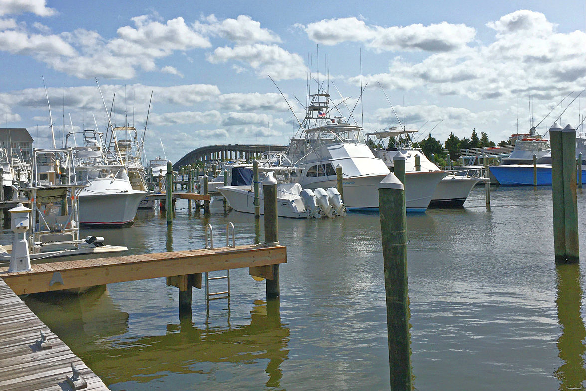 Fishing charter boats Pirates Cove outer banks beach SAGA Realty and Construction