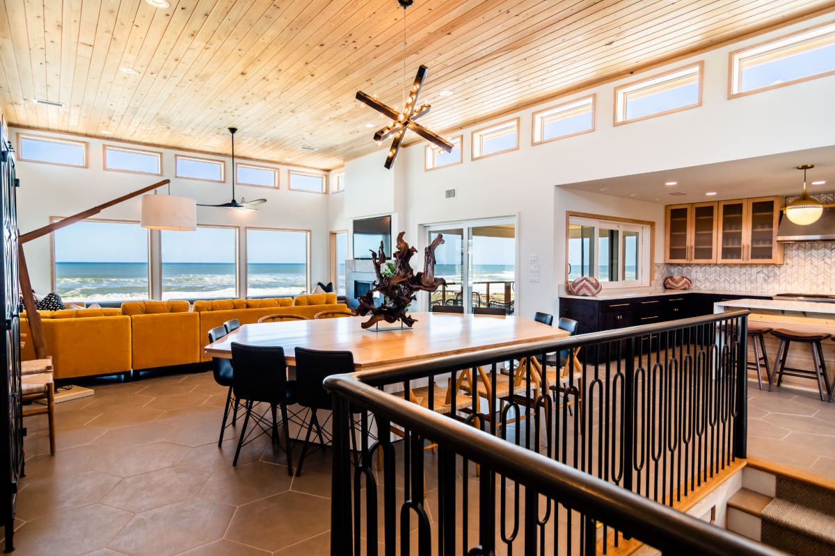 Light makes all the difference in an open floor plan on the Outer Banks by SAGA